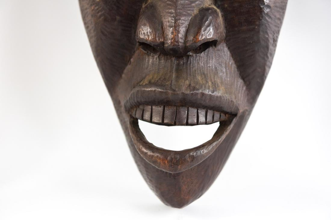 GROUPING OF HAITIAN CARVED WOODEN MASKS - 4