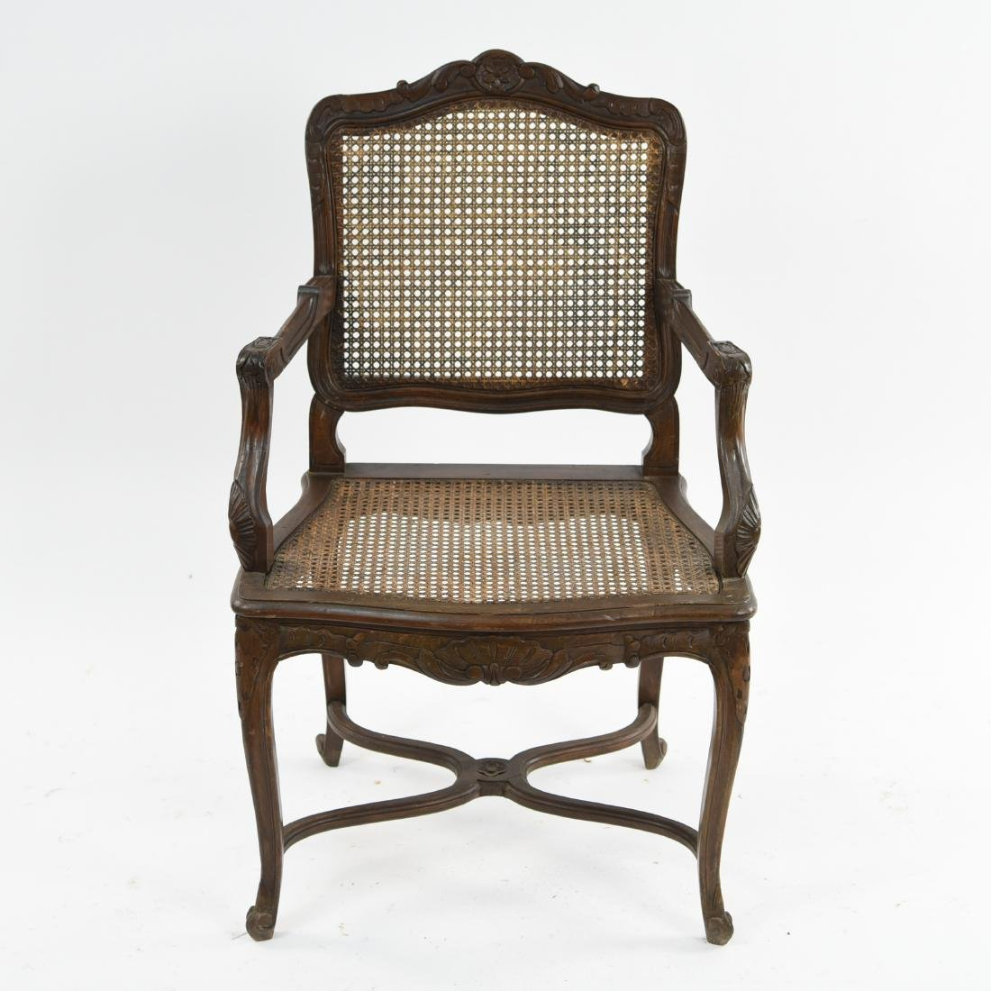 CARVED AND CANED ARMCHAIR