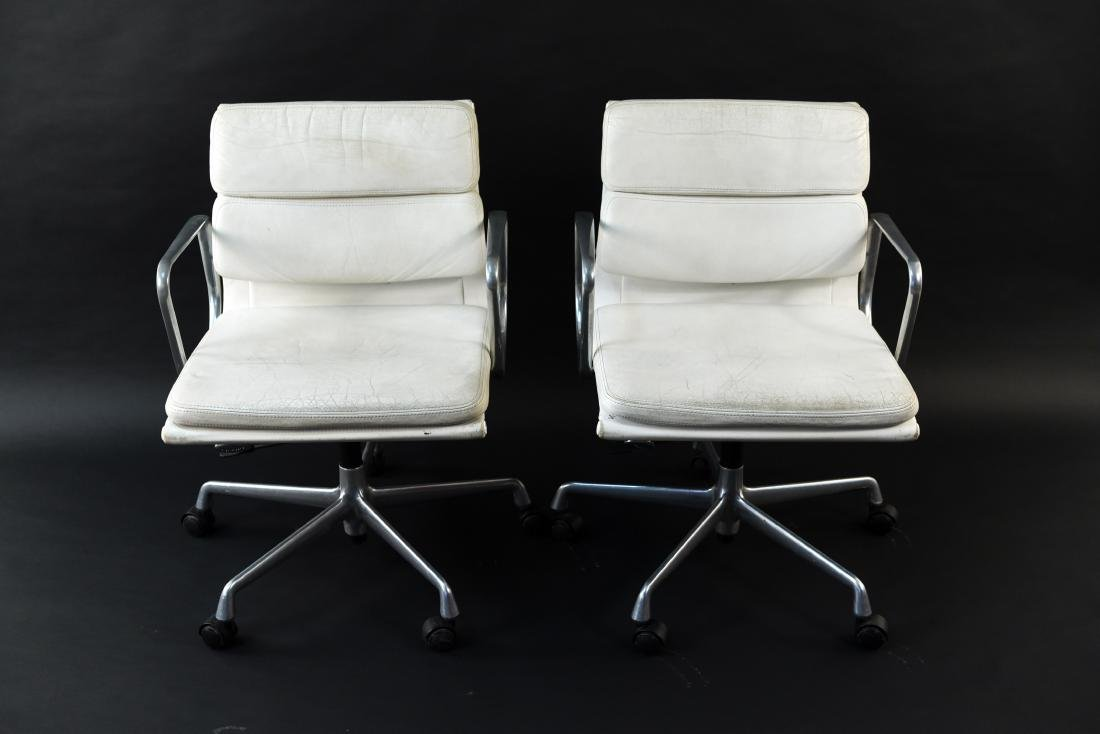 PAIR OF EAMES SOFTPAD ARMCHAIRS