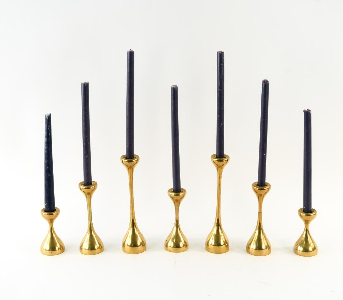 MID-CENTURY GRADUATED HEIGHT BRASS CANDLESTICKS