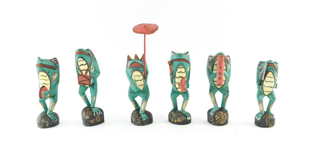 GROUPING OF FOLK ART WOODEN FROGS - 2