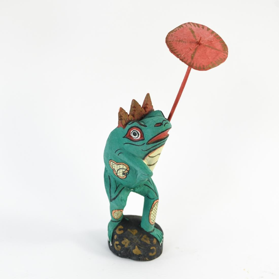 GROUPING OF FOLK ART WOODEN FROGS - 6