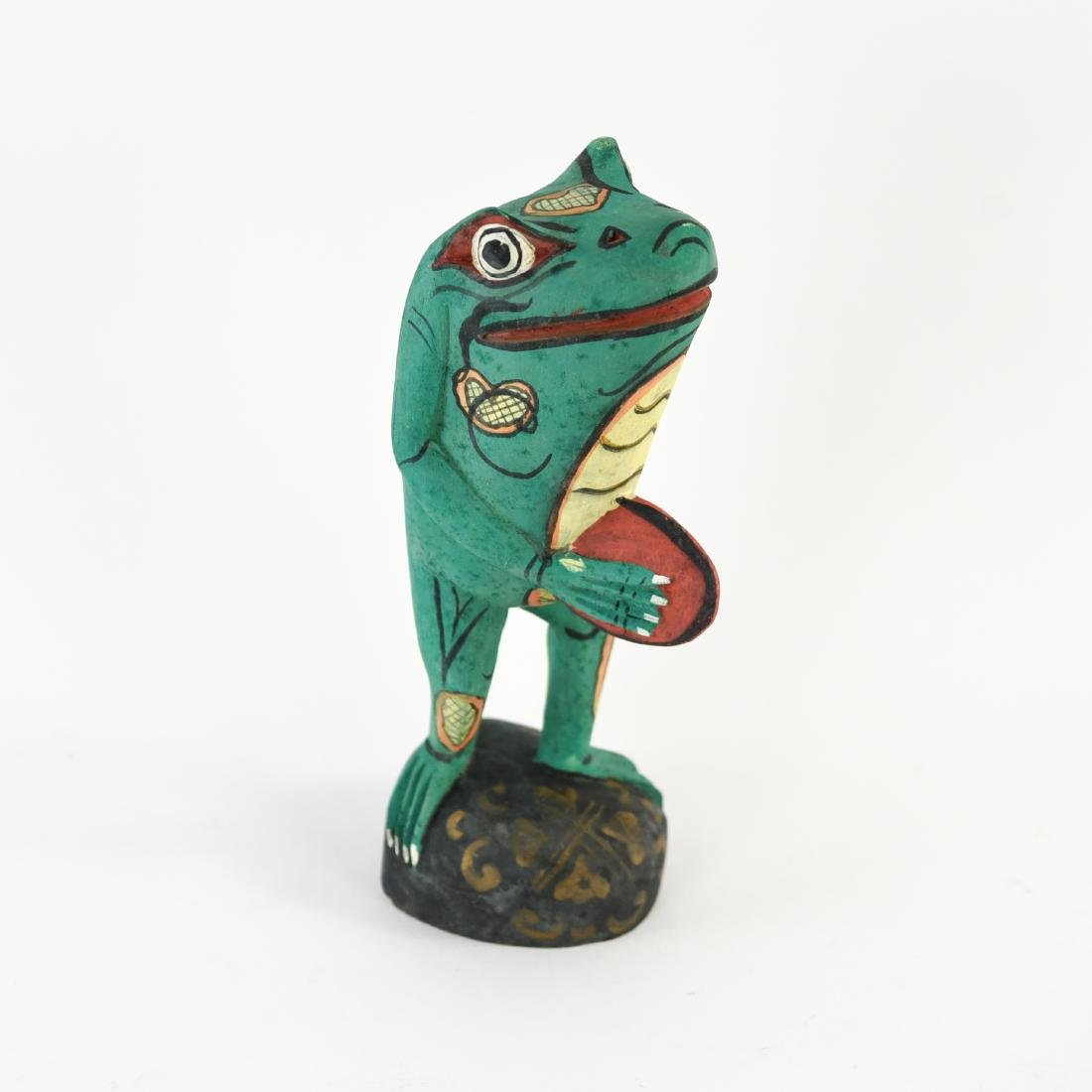 GROUPING OF FOLK ART WOODEN FROGS - 8
