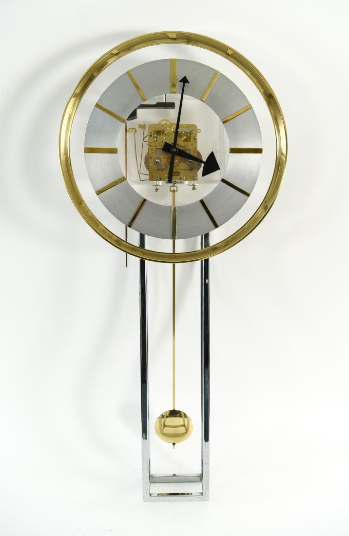HOWARD MILLER MODERN GLASS & BRASS WALL CLOCK
