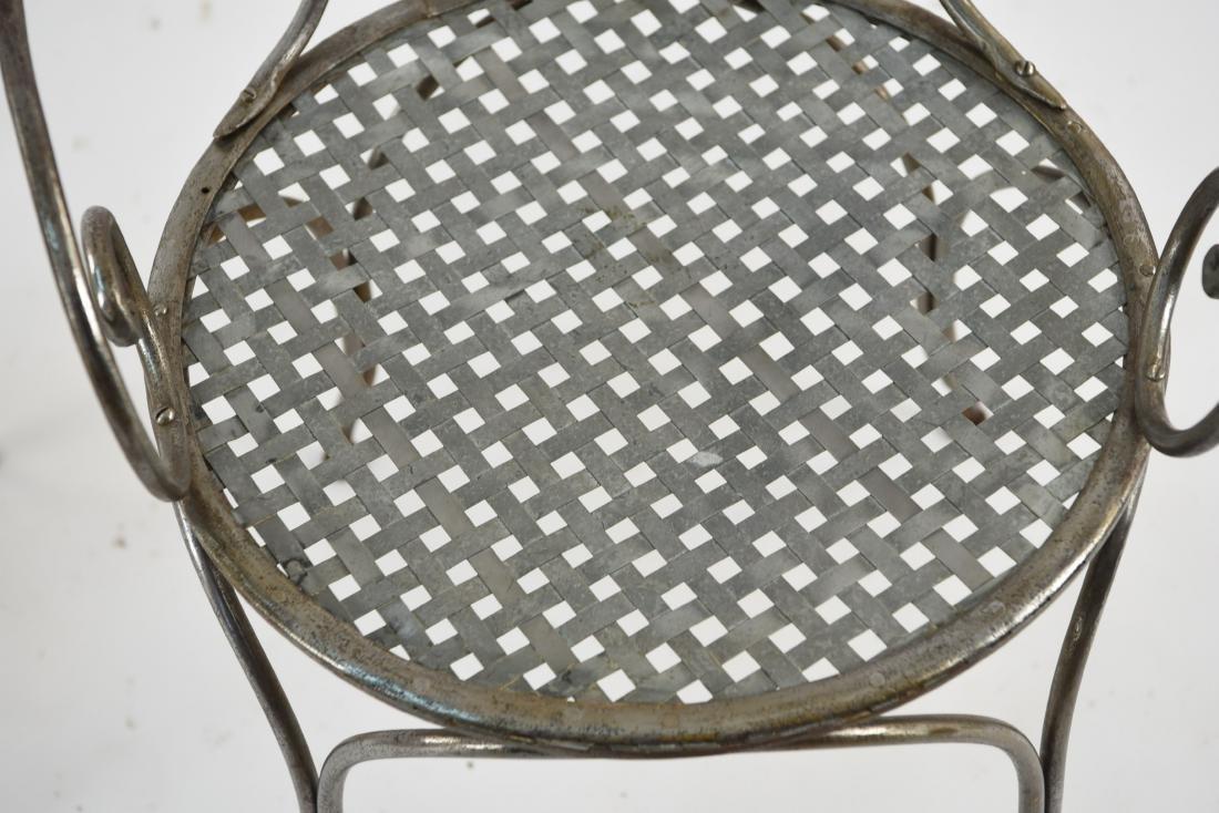 (2) SCROLLING IRON CHAIRS W/ WOVEN METAL SEATS - 10
