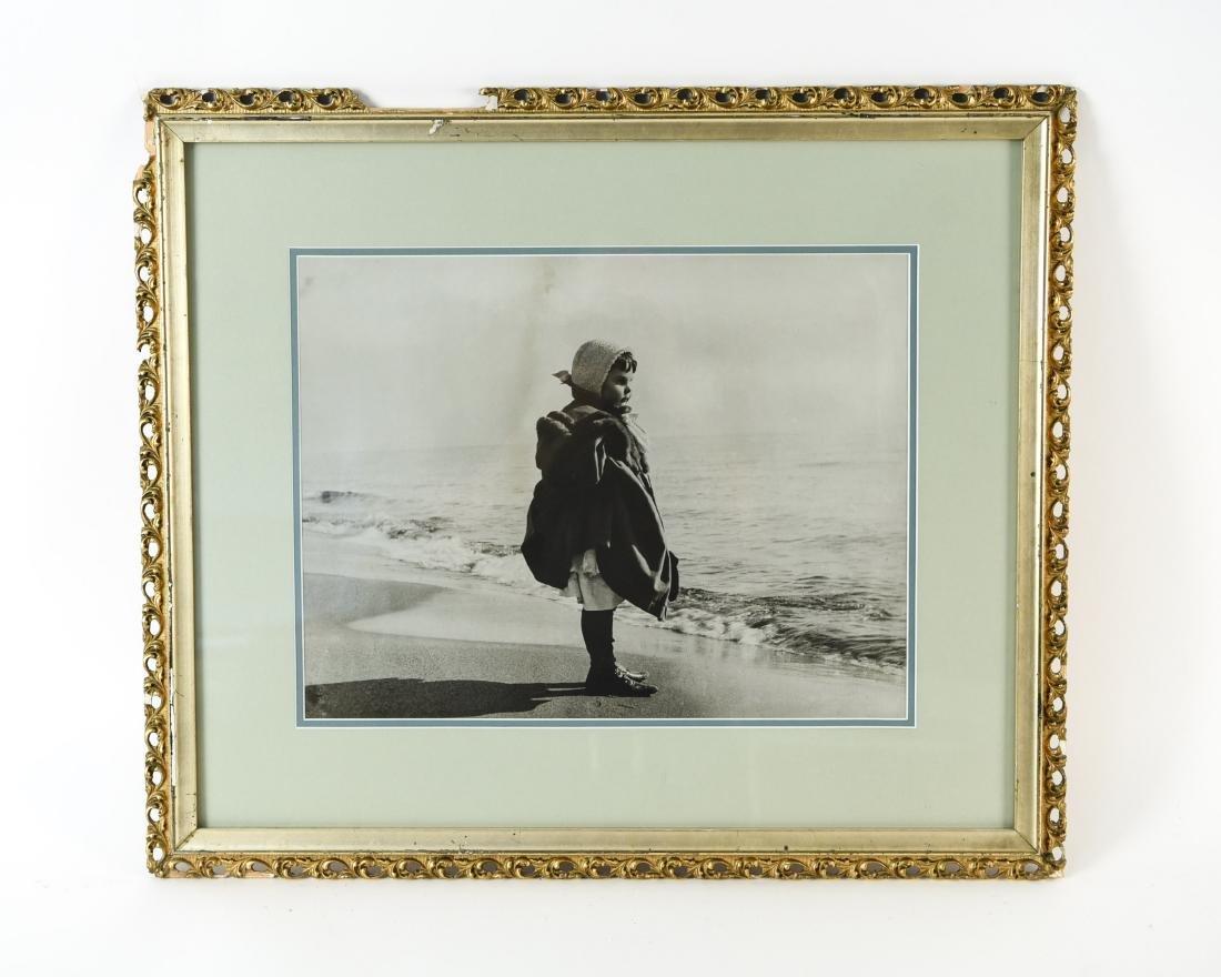 C. 1900 PHOTOGRAPH OF A GIRL ON A BEACH