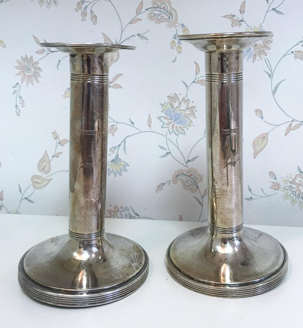 WEIGHTED SILVER CANDLESTICKS