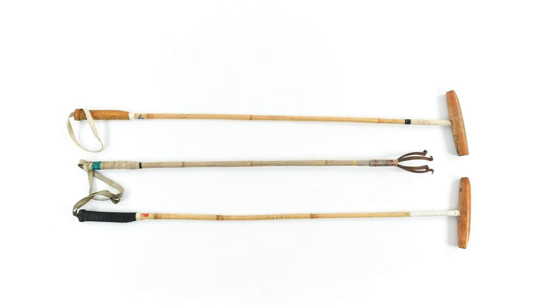 (2) POLO MALLETS AND A BALL CATCHER