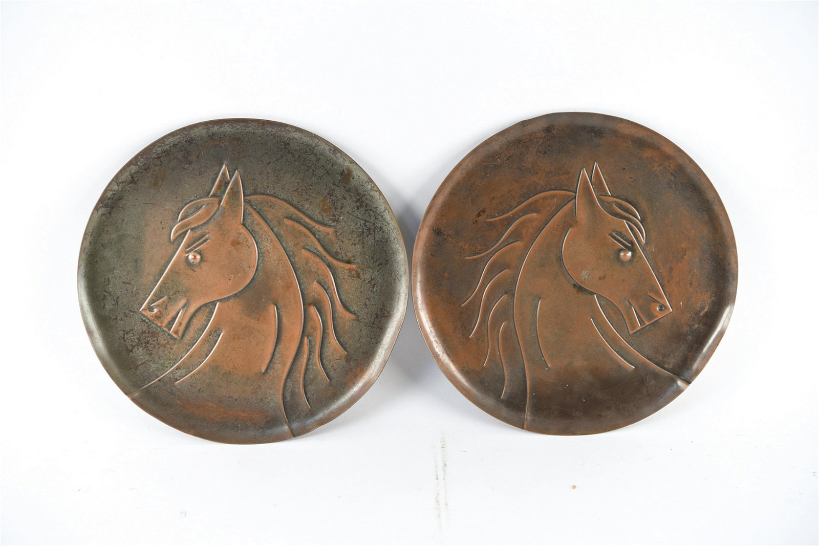 PAIR OF HAND HAMMERED COPPER HORSE RELIEFS