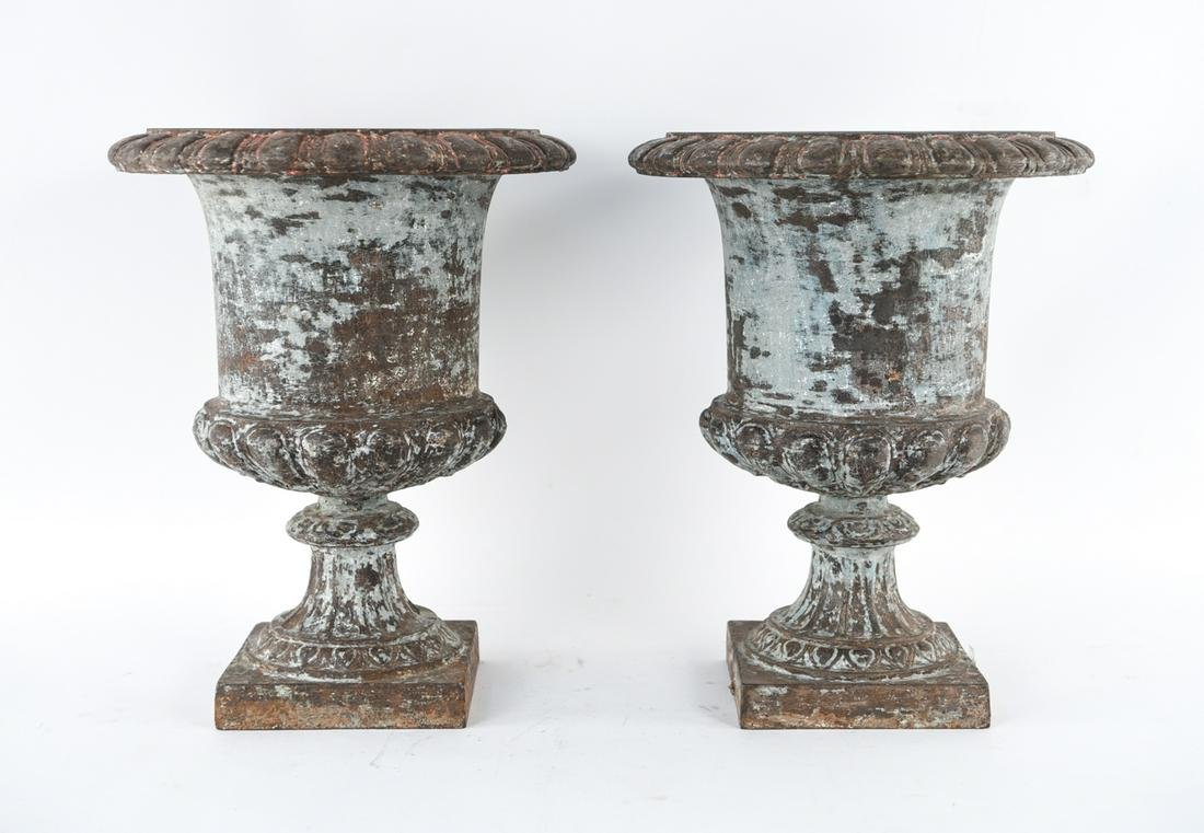 PAIR OF CAST IRON OUTDOOR PLANTERS