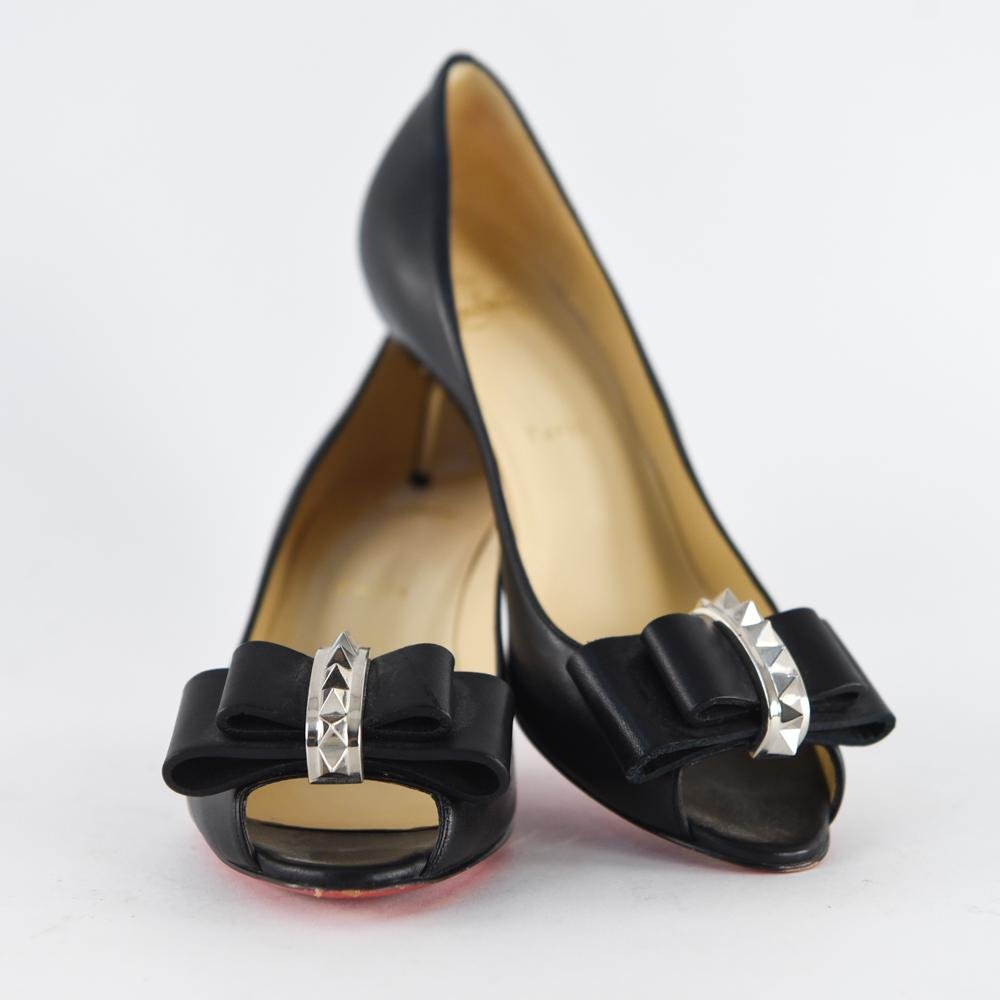 PAIR OF CHRISTIAN LOUBOUTIN SPIKE BOW HEELS