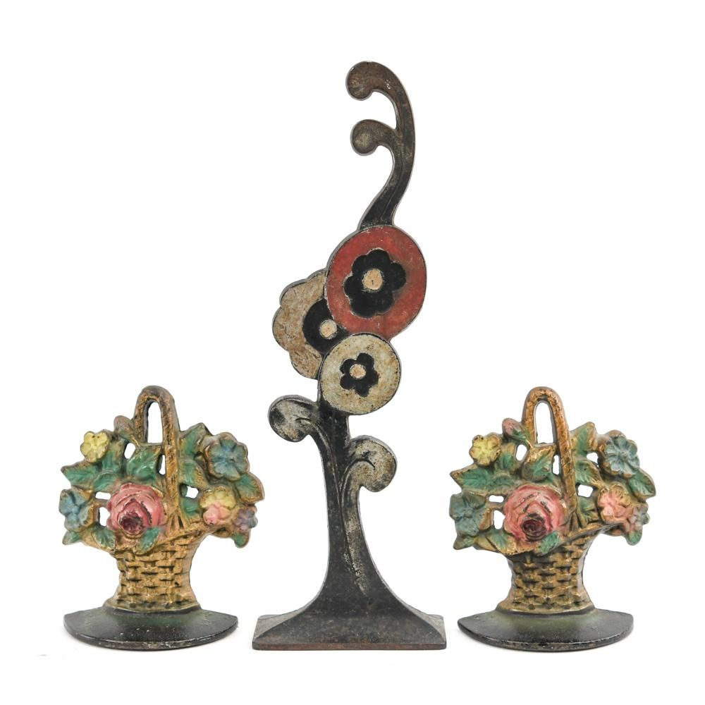 (3) FLORAL CAST IRON DOOR STOPS