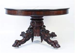 19TH C. HEAVILY CARVED MAHOGANY CLAW FOOT TABLE