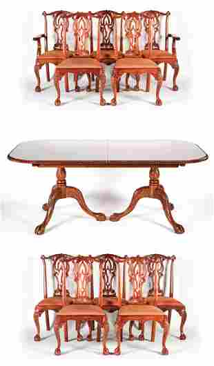 CARVED MAHOGANY DINING TABLE AND CHAIRS