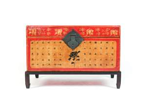 CHINESE RED LACQUER TRUNK ON STAND