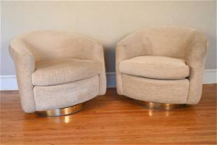 PAIR OF SWIVEL TUB CHAIRS ON BRASS BASES