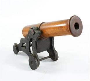 ANTIQUE DIMINUTIVE TURNED WOODEN CANNON