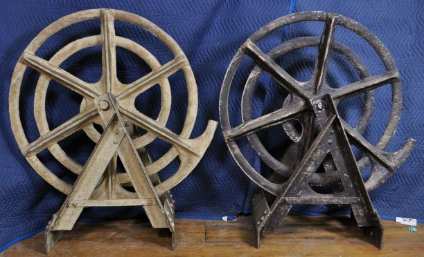 6: LARGE CAST IRON SPIRAL WHEELS