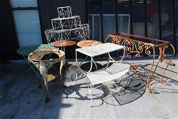 Large grouping of iron outdoor furniture incl