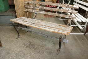 Rustic Wood And Iron Park Bench.