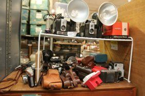 Large Grouping Of Cameras And Camera Accessories