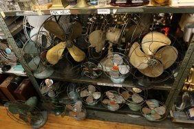 Two Shelves Of Fans.