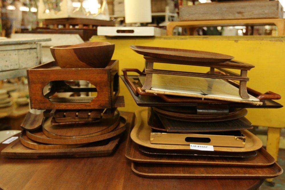 Large grouping of Danish teak and wood trays .