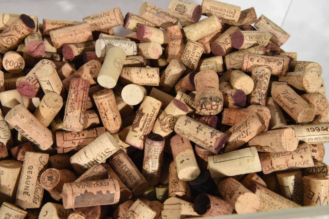 GROUPING OF WINE CORKS - 9