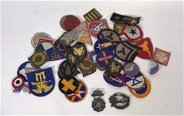 GROUPING OF MILITARY INSIGNIA PATCHES ETC.