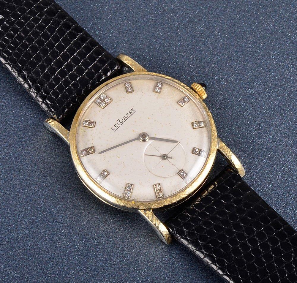 147: Le Coultre 18k man's wrist watch