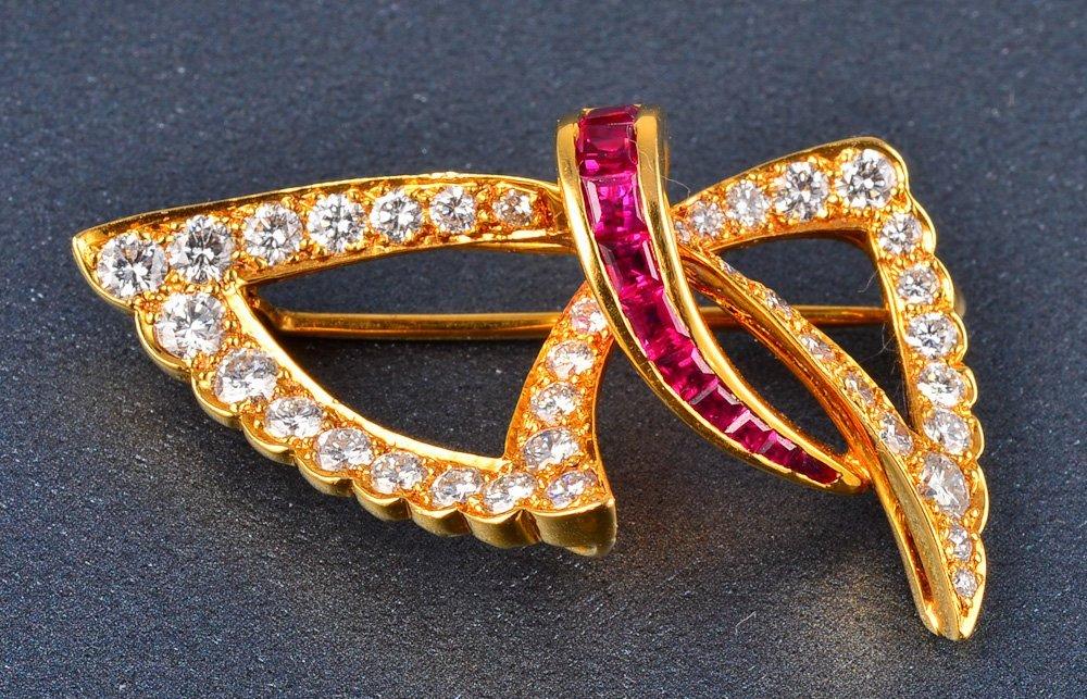 160: Fine 18K diamond and ruby bow brooch