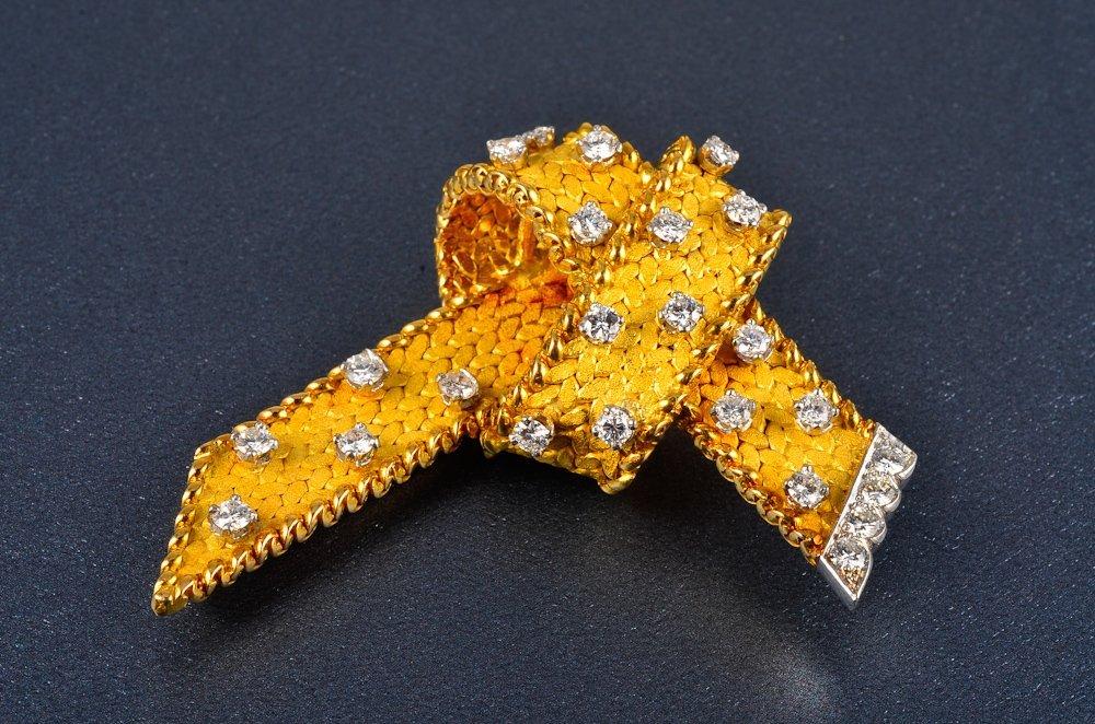 165: French 18K gold diamond ribbon style brooch