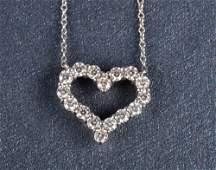 226: Tiffany & Co diamond heart pendant necklace
