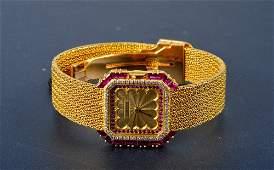 "251: ""Cartier 18K yellow gold & diamond & ruby wristwa"