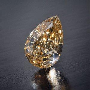 387: Very Rare 29.56 Pear Shape Fancy Brown Yellow Diam