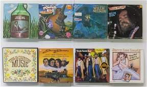 7 Assembled Vinyl Records and 1 Box Set