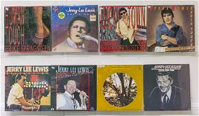 8 Assembled Vinyl Records