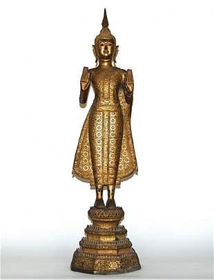 Impressive 19th Century Thai Standing Gilt Buddha.