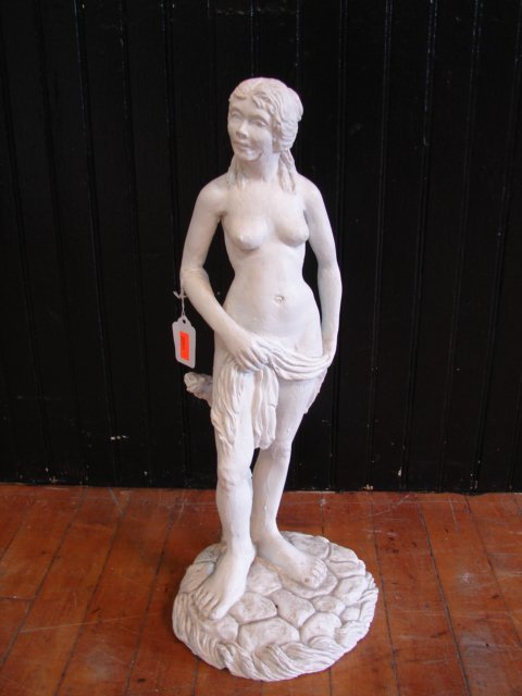 22: Plaster figure of woman,