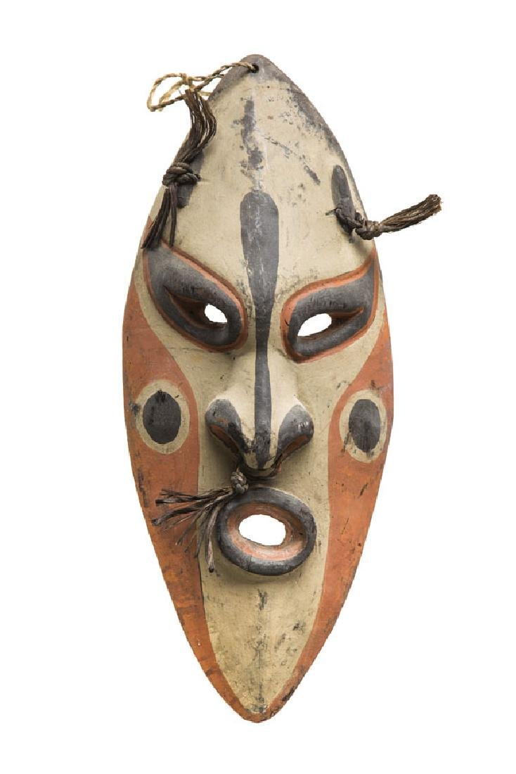 Canoe shield mask, 1990s; relief, mixed media on wood,