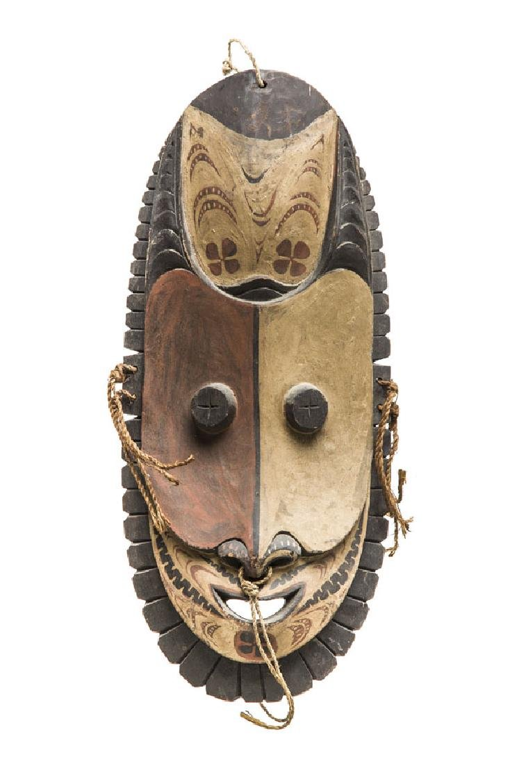 Ancestor Mask, 1990s; relief, mixed media on wood, 48 x