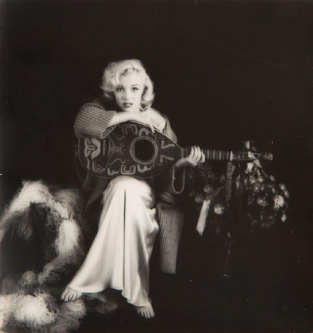Milton H. Greene (1922 - 1985) Marilyn Monroe with a