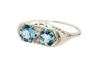 Aquamarine and diamond ring, around the middle of the