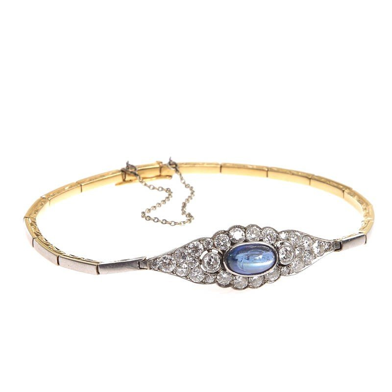 26: Gold bracelet with sapphire , France (?), 1930