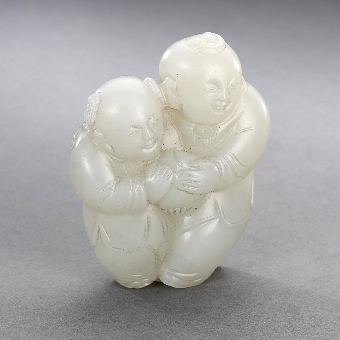 A CHINESE WHITE JADE CARVING OF BOY GROUP