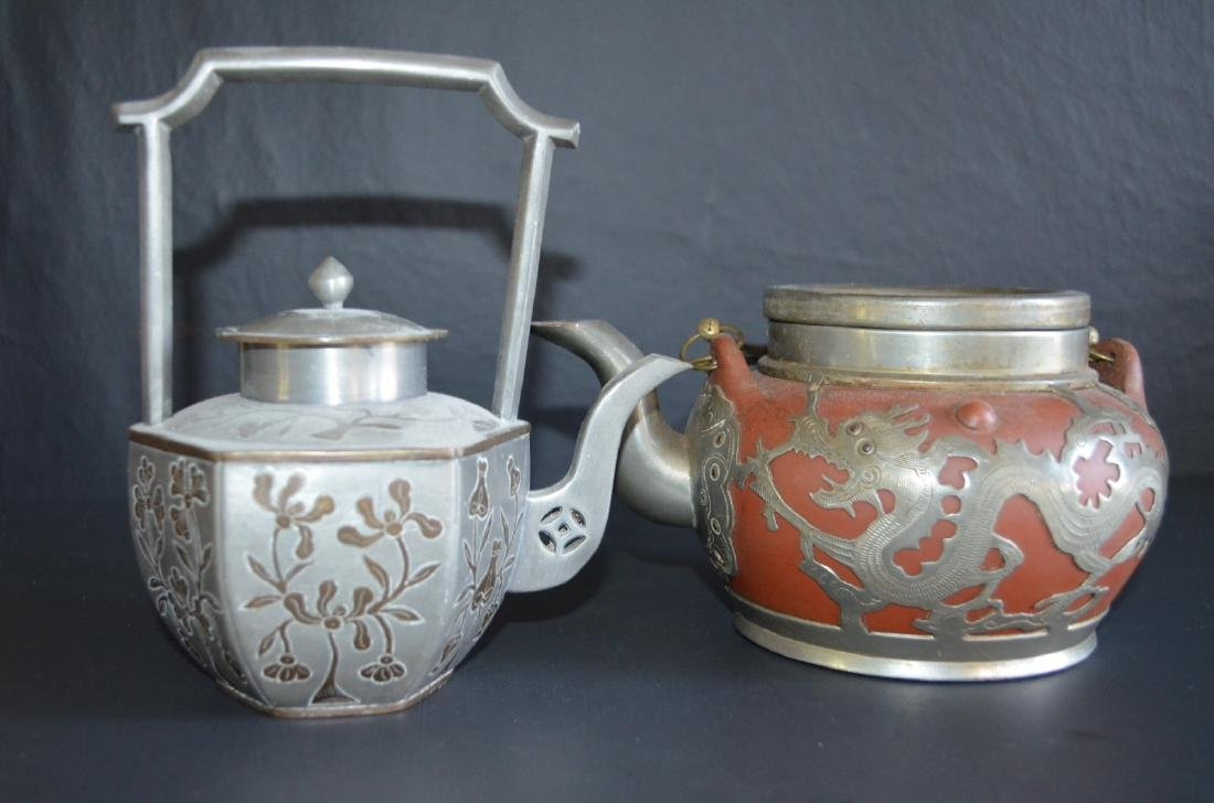 Two Chinese tea pots.