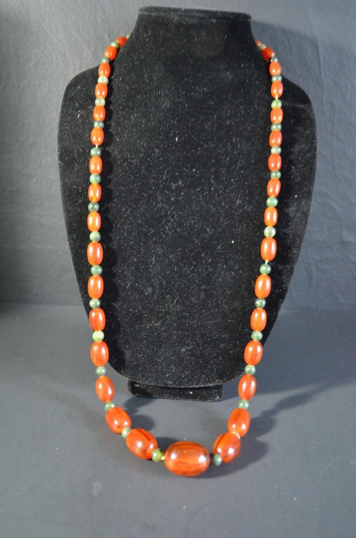 Chinese cheery amber necklace with jade