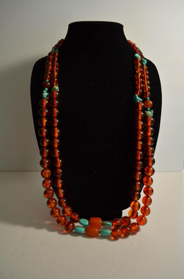 Two pieces of amber and turquoise necklaces