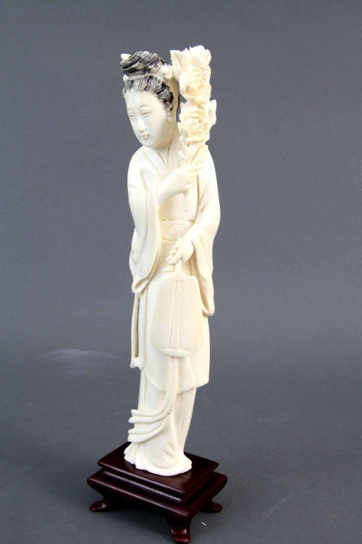 22: Chinese Ivory Carving of Lady Holding Flower