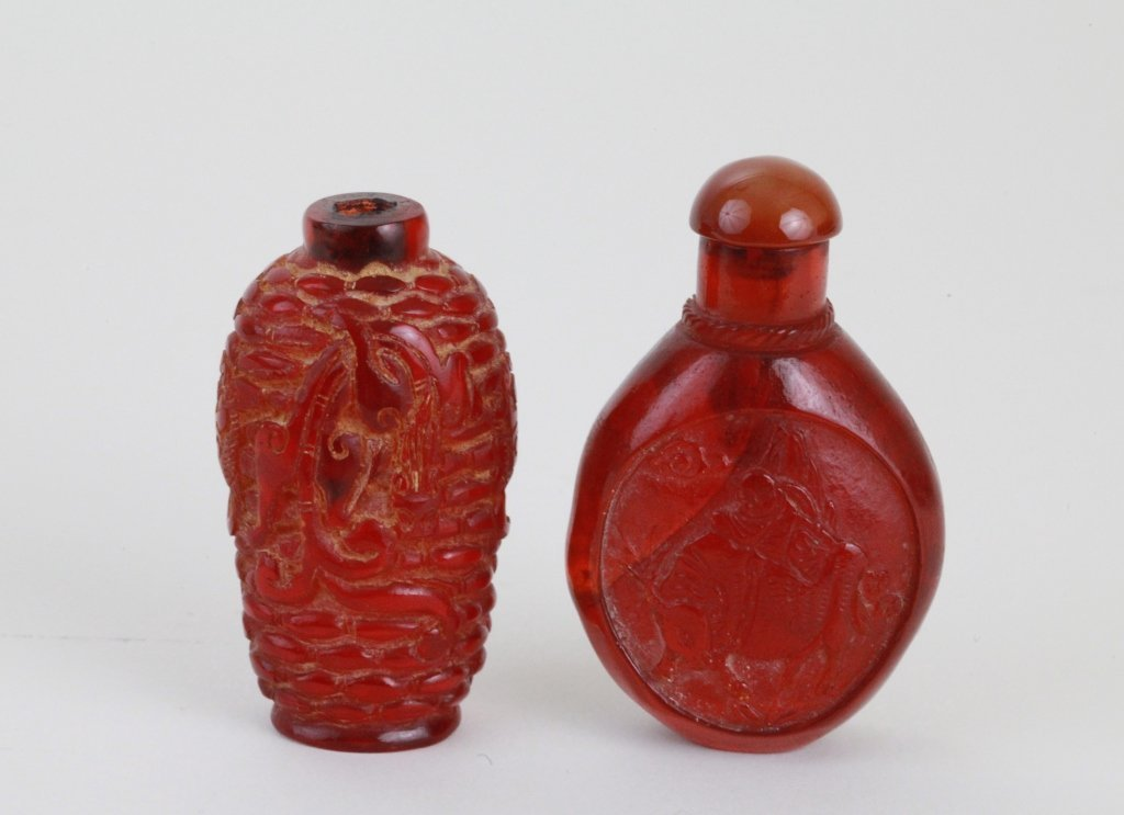 18: Two Pieces of Chinese Carved Amber Snuffle Bottles